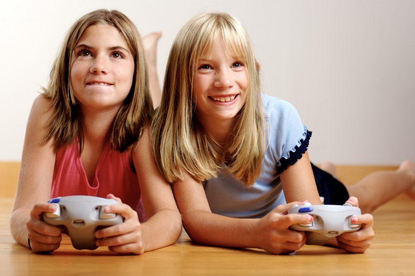 2 Girls playing video game